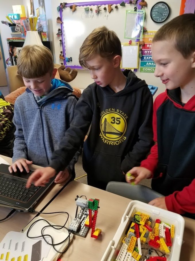 Students programming with Legos