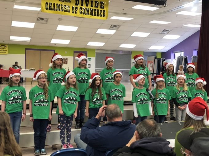 Students singing at Christmas event