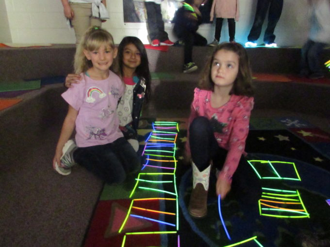 Students building with glow sticks